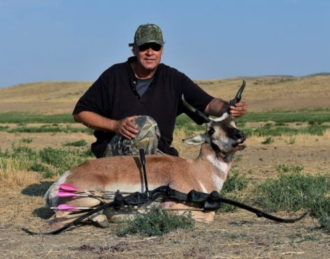 A Hunter Poses With A Pronghorn Antelope, Taken In Northern Colorado With A Hoyt Satori Traditional Takedown Recurve and Easton Axis Carbon Arrows. Photography by Michael Patrick McCarty