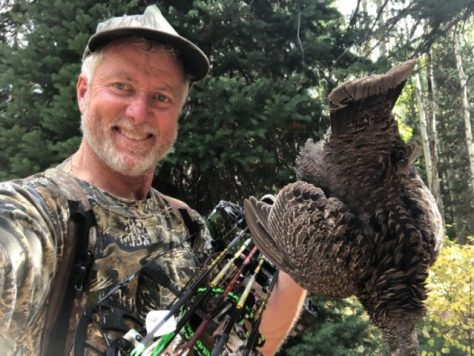 A Bowhunter Poses With a Dusky Grouse, Otherwise Known As A Blue Grouse, Harvested With A Compound Bow in Western Colorado