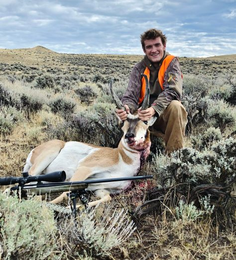 A Hunter Poses With A Trophy Pronghorn Antelope Buck, Taken With A High Caliber Rifle On The Sagebrush Flats of Northern Colorado