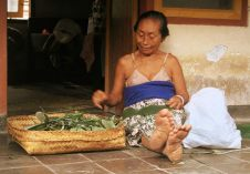 Balinese women making offerings