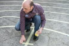 Taping the center of the labyrinth