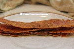 Stack of crispy turky bacon on a plate.