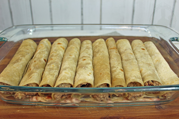 Burritos rolled up placed in baking dish