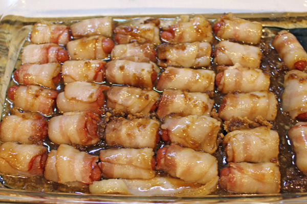 Bacon wrapped smokies flipped midway through baking process