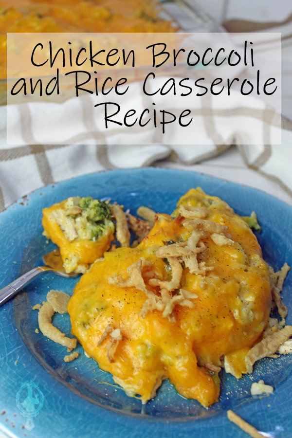 A serving of Chicken Broccoli and Rice Casserole on a blue plate with a bite on a fork ready to eat. The casserole dish is in the background with a serving missing.