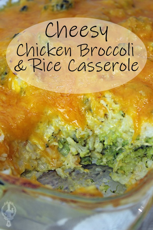 Close up of the entire Chicken Broccoli and Rice Casserole with a serving missing, showing the ingredients underneath all that cheese.