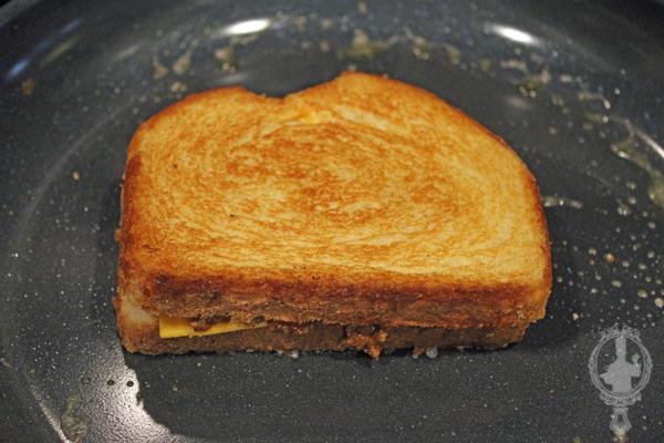 Sloppy Joe Grilled Cheese in a frying pan finsihing cooking.