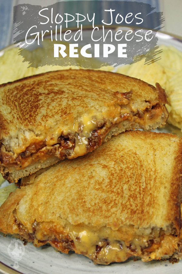 Two halves of Sloppy Joe Grilled Cheese with potato chips in the background.