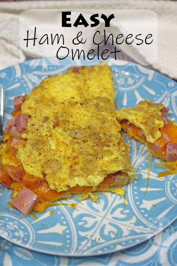 Ham and Cheese Omelet cut and missing bites.