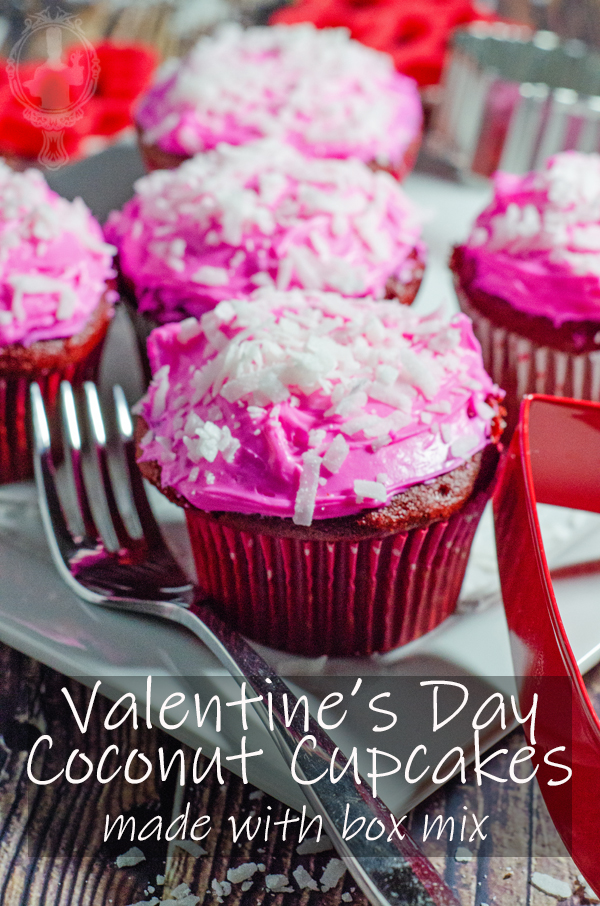 Close up of valentines day coconut cupcakes with a fork on the left side.