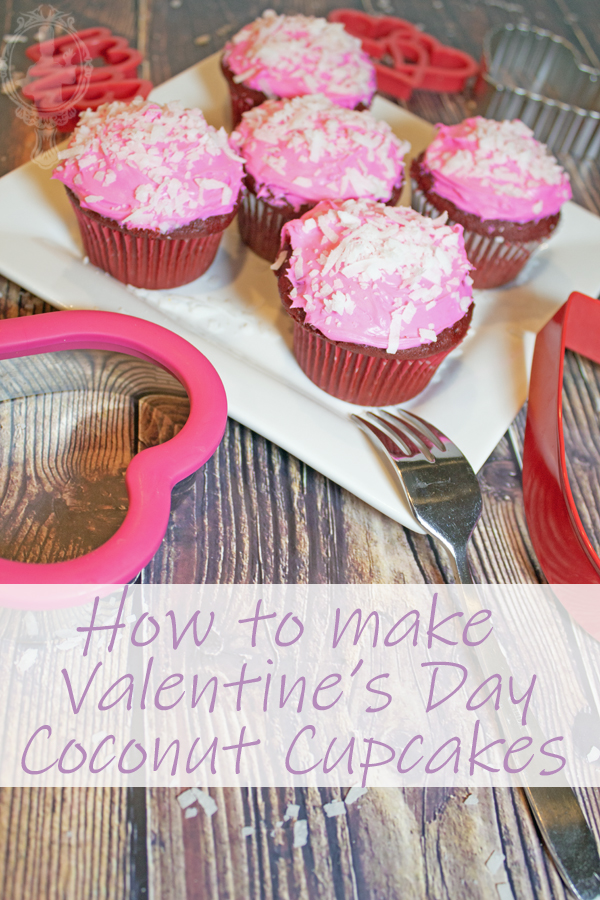 A white plate of valentines day coconut cupcakes with pink icing, sprinkled with coconut.