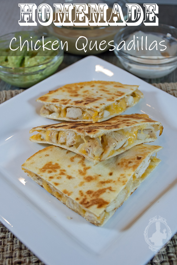 3 wedges of the chicken quesadillas on a white plate with extras in the background.