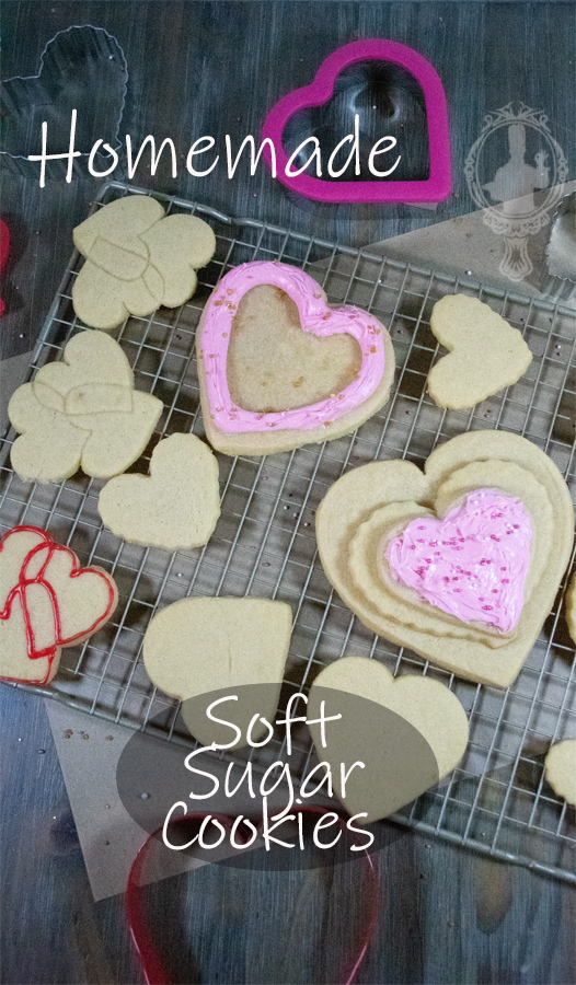 Overhead view of cut out soft sugar cookies on a cooling rack with a couple frosted.