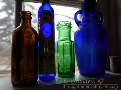 Four bottles on my windowsill.