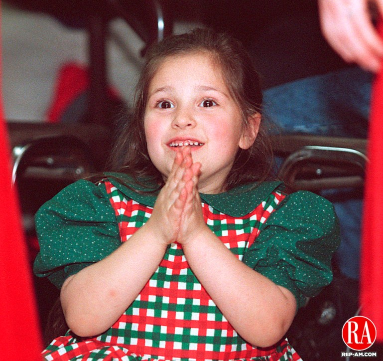 MIDDLEBURY, CT 12/20/98 --1220JH08.tif--Megan Devine, 6, of Bethlehem watched with delight as some of the other   children danced  during the Horgan Academy of Irish Dance