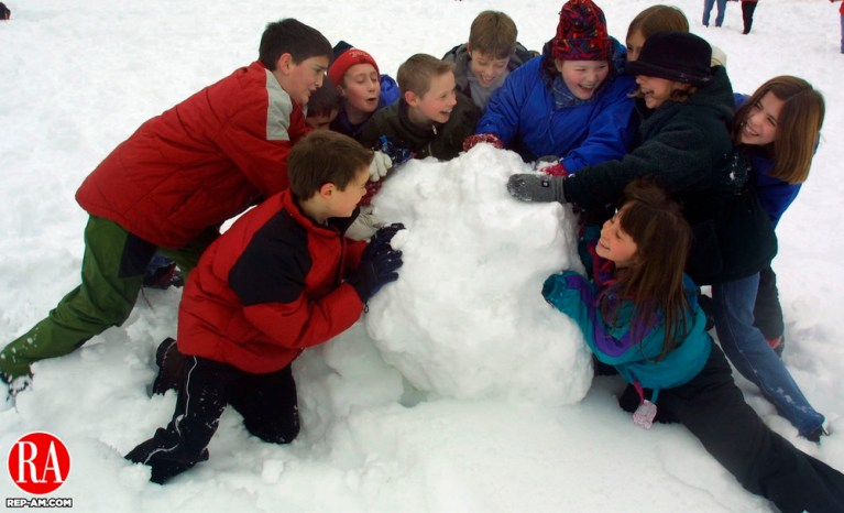 OXFORD, CT 2/9/01--0209TK09.tif  (left to right:)Fourth graders strain to build a large base for a snowman at the Oxford Center School as they participated in a snowmaking competition held Friday afternoon on school grounds.--TOM KABELKA staff photo for STANDALONE PHOTO