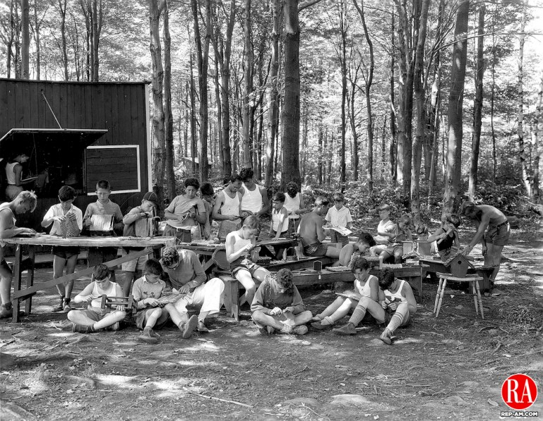 Local youngsters woodworking at a YMCA camp in the area, 1933.