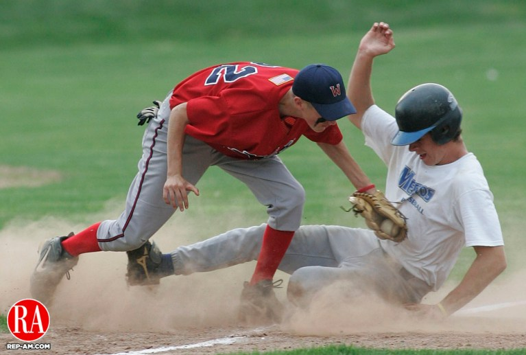 WATERTOWN, CT -22 July 2005- 072205BZ06- Bridgeport #18, Dan West slides safely into third as Wolcott #22, Dave Antonucci tries unsuccessfully to make the tag during the championship round of the Mickey Mantle Tournament Friday evening. A passed ball scored a run and advanced West to third. Jamison C. Bazinet photo