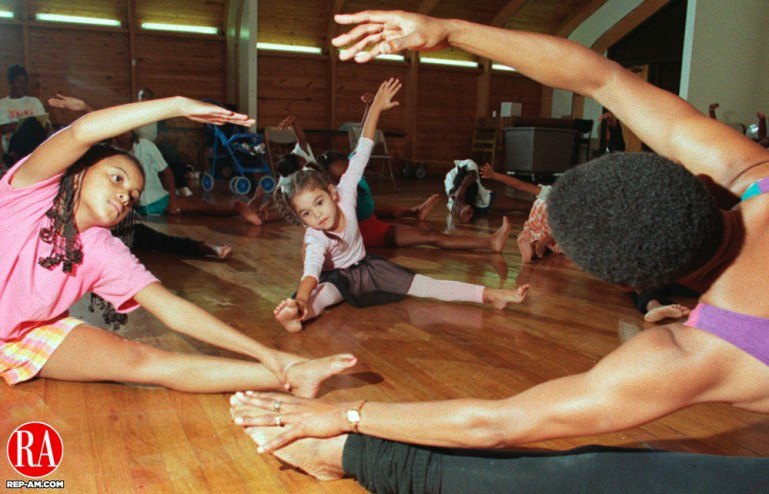 WATERBURY, CT.--9/14/98--0914MA05.tif-Dance instructor Rolanda Mitchell, back towards camera, gets dancers limbered up during their first day of dance class at the N.O.W. auditorium in Waterbury Monday.The Unity Dance Ensemble, which offers educational experiences in African, Caribbean and Latino Dance and Drum is run by artistic director Marie Baskerville. Fall registration is now being taken.  Ages 6-teens are welcome.  Classes are held Monday and wednesday. Beginners calsses run from 5-6:00 P..M. and Intermediate classes from 6-7:00 p.m. Those interested in signing up should call Marie Baskerville at area code (860) 589-5542.MICHAEL ASARO staff photo for Metro