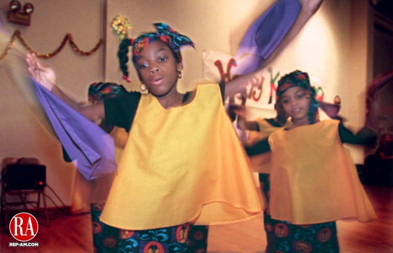 December 20, 1998 - WATERBURY, - Janay Sylvister (C) of Waterbury performs a welcome dance as part of the second annual Kwanzaa performance held 20 December at the New Opportunities for Waterbury organization in downtown Waterbury.   Photo by Doug Collier Republican-American