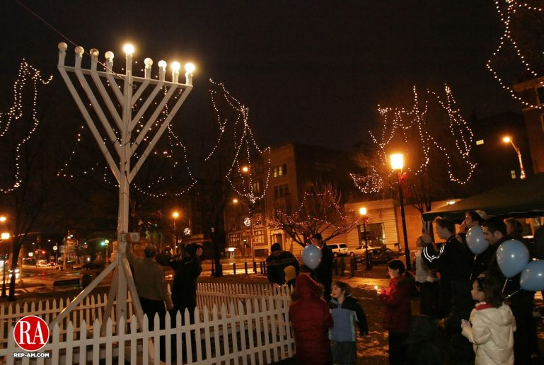 WATERBURY, CT 26 December 2005 -122605BZ03-    Rabbi Joseph Eisenbach presided over a menorah lighting on the green in Waterbury Monday night.  The lighting is sponsored by the Chabad Lubavitch of the Northwest Corner.    Jamison C. Bazinet Republican-American