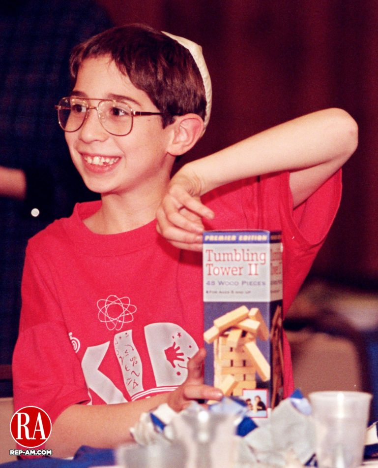 December 13, 1998 - WATERBURY - Matthew Perreault, 9, of Waterbury had to struggle a bit to open the box of wooden blocks he got as a gift during the celebration of the first night of Hanukkah Sunday evening at Beth El Synagogue in Waterbury. The members of the synagogue were joined by members of B