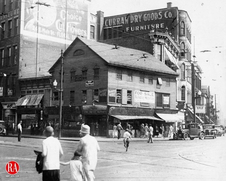 The Brown Block at the corner of East and South Main Streets, Waterbury. This is one of the last photographs taken of this Exchange Place before new construction began in summer of 1930.
