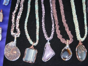 Pendants of wire wrapped stones by James Smith. Hemp work by me.