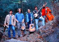 A photo of five individuals holding instruments. Up and coming Richmond neo-bluegrass band, South Hill Banks.