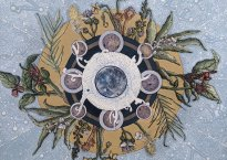 """Light blue-grey background, depicting an ornate design with intertwined flowers, moons, and leaves. White text at the top and bottom reads, """"Itai Kriss and Telavana; Supermood"""""""