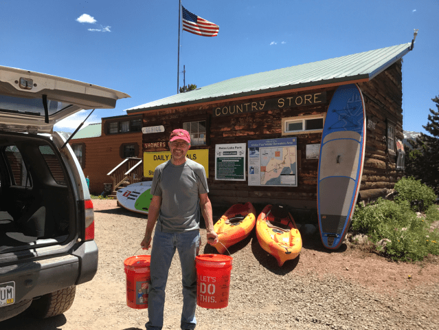 Ray dropping off Resupply Buckets at Molas Lake Campground