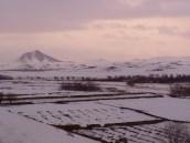 Verschneite Felder im abendlichen Zabul. Foto: Thomas Ruttig (2005).