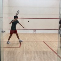 Eighth grader Drew Glaser '24 bounces up to varsity squash