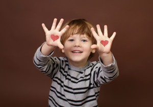 Valentine's Day Love Theme: Child Showing Picture of Hearts on Palms of his Hands