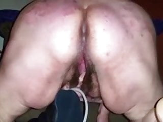 Fat whore cums on a huge dildo