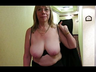 Granny Reba knockers out in a resort hallway.
