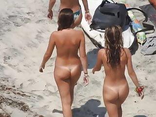 Radiant nudist teenagers on the seashore