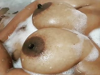 Taking part in with my hot colossal knockers within the bathtub tub