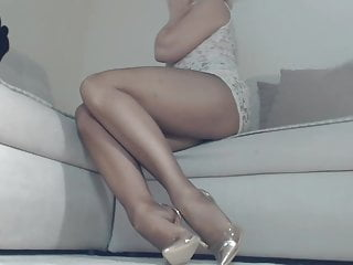 Lengthy legs   in pantyhose and heels