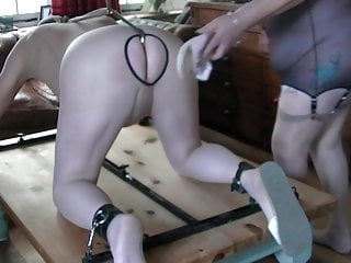 Nylon slave spanked with scholl sandal