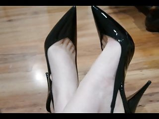 My bare feet in my black heeled pumps