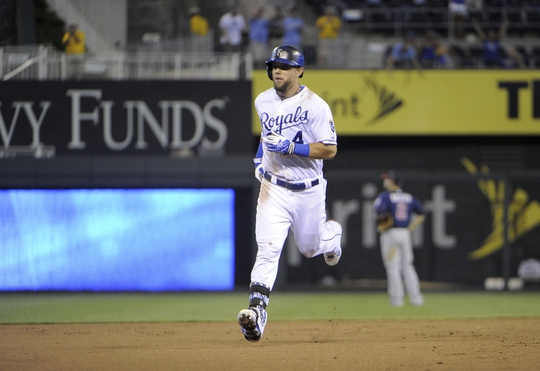 Aug 26, 2014; Kansas City, MO, USA; Kansas City Royals left fielder Alex Gordon (4) runs the bases after hitting a two run walk off home run against the Minnesota Twins in the ninth inning at Kauffman Stadium. Kansas City won the game 2-1. Mandatory Credit: John Rieger-USA TODAY Sports