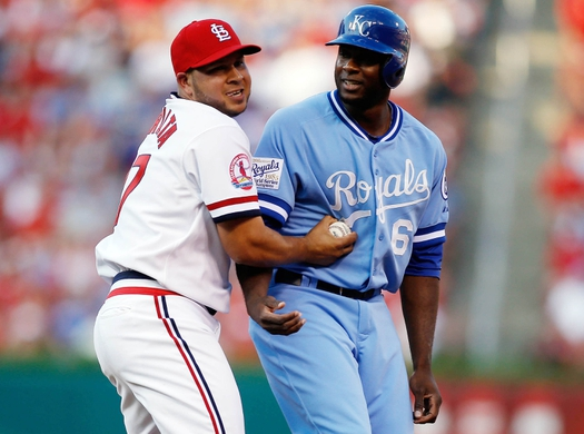 Jul 23, 2015; St. Louis, MO, USA; St. Louis Cardinals shortstop Jhonny Peralta (27) tags out Kansas City Royals center fielder Lorenzo Cain (6) during the third inning of a baseball game at Busch Stadium. Mandatory Credit: Scott Kane-USA TODAY Sports