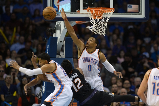 Oct 28, 2016; Oklahoma City, OK, USA; Phoenix Suns forward T.J. Warren (12) is fouled by Oklahoma City Thunder guard Andre Roberson (21) and guarded by Oklahoma City Thunder guard Russell Westbrook (0) during the second quarter at Chesapeake Energy Arena. Mandatory Credit: Mark D. Smith-USA TODAY Sports