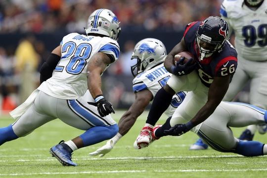 Oct 30, 2016; Houston, TX, USA;  Houston Texans running back Lamar Miller (26) runs as Detroit Lions cornerback Quandre Diggs (28) defends during the first half at NRG Stadium. Mandatory Credit: Kevin Jairaj-USA TODAY Sports