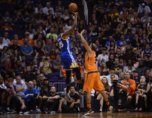 Oct 30, 2016; Phoenix, AZ, USA; Golden State Warriors forward Kevin Durant (35) shoots over Phoenix Suns forward Jared Dudley (3) during the first half at Talking Stick Resort Arena. Mandatory Credit: Joe Camporeale-USA TODAY Sports