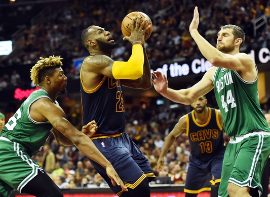 Nov 3, 2016; Cleveland, OH, USA; Cleveland Cavaliers forward LeBron James (23) drives to the basket between Boston Celtics guard Marcus Smart (36) and center Tyler Zeller (44) during the second quarter at Quicken Loans Arena. Mandatory Credit: Ken Blaze-USA TODAY Sports