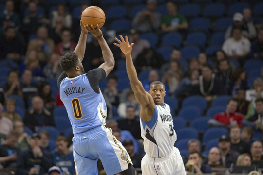Nov 3, 2016; Minneapolis, MN, USA; Denver Nuggets guard Emmanuel Mudiay (0) shoots the ball over Minnesota Timberwolves guard Kris Dunn (3) in the second half at Target Center. The Nuggets won 102-99. Mandatory Credit: Jesse Johnson-USA TODAY Sports