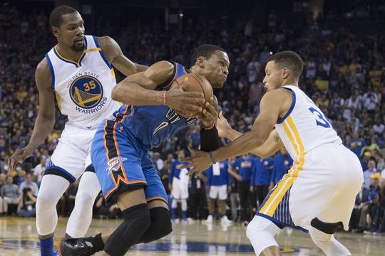 November 3, 2016; Oakland, CA, USA; Oklahoma City Thunder guard Russell Westbrook (0) dribbles between Golden State Warriors forward Kevin Durant (35) and guard Stephen Curry (30) during the second quarter at Oracle Arena. Mandatory Credit: Kyle Terada-USA TODAY Sports