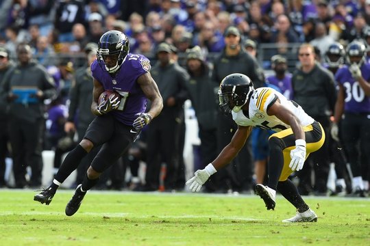 Nov 6, 2016; Baltimore, MD, USA; Baltimore Ravens wide receiver Mike Wallace (17) catches a pass in front of Pittsburgh Steelers cornerback Artie Burns (25) during the first quarter at M&T Bank Stadium. Mandatory Credit: Tommy Gilligan-USA TODAY Sports